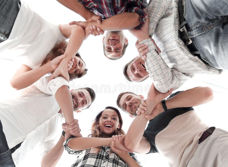 Happy group of businesspeople stacking their hands in cooperation royalty free stock image