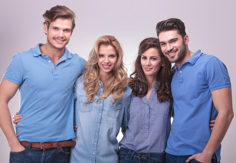 Happy group of casual poeple standing embraced royalty free stock photo