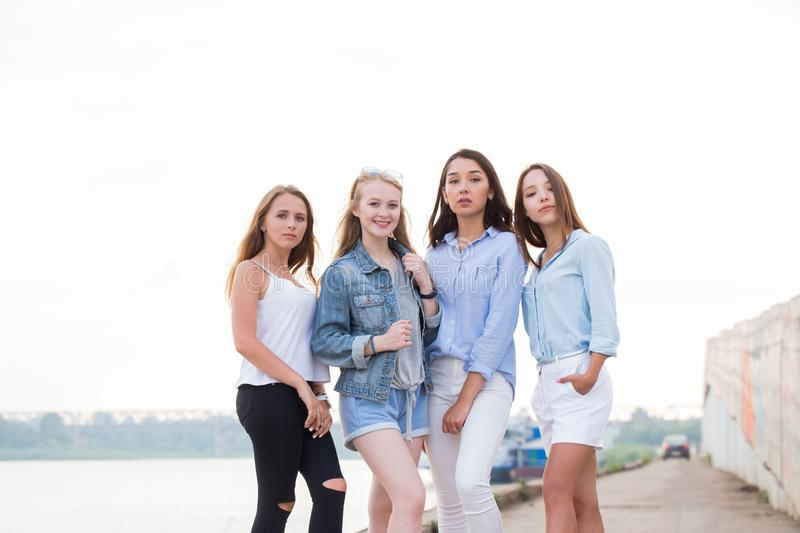 Happy group of female friends looking at camera and smile. Young girl student after College. Lifestyle, youth, summer, relax, communication concept stock photos