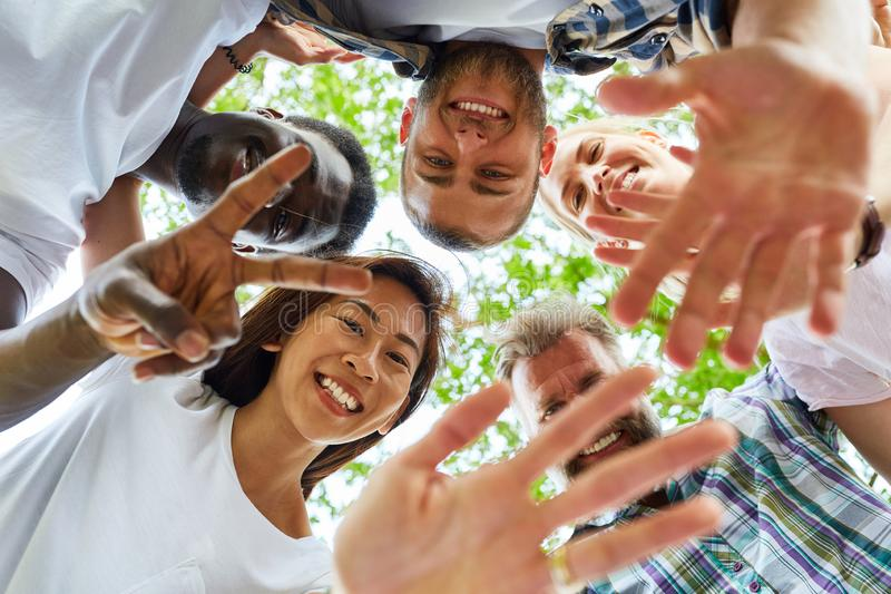 Happy group of friends form a circle royalty free stock image