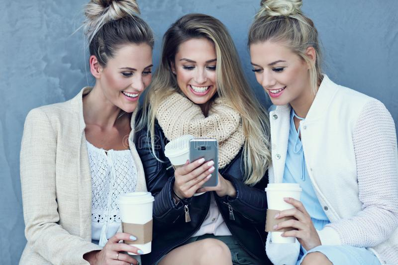 Happy group of friends taking selfie outside in autumn season stock images