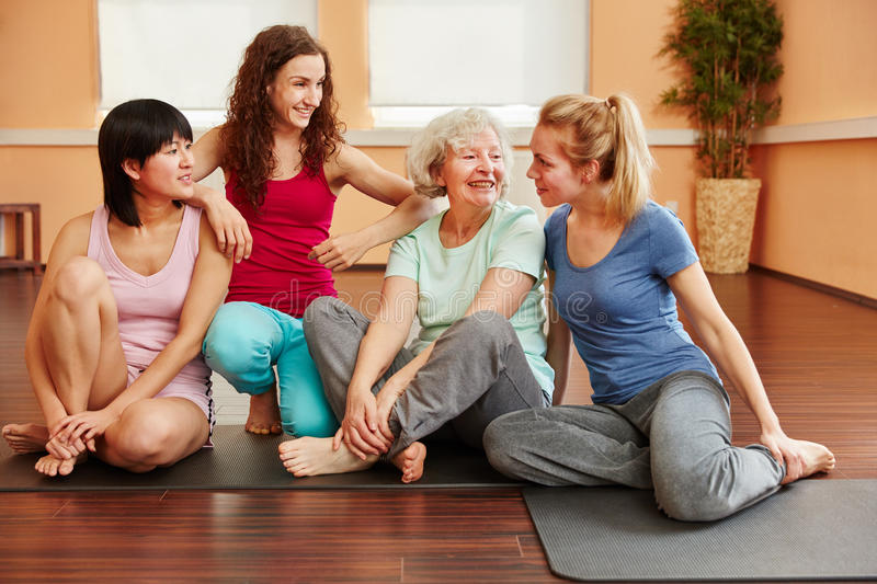 Happy group of friends in yoga class break royalty free stock images