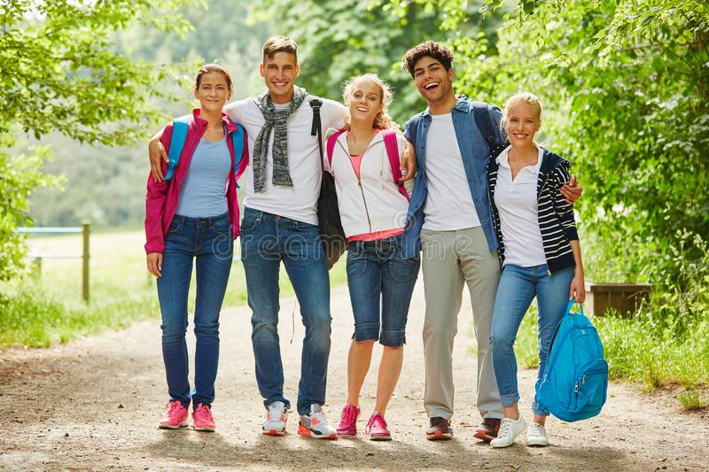 Happy group of hiking friends stock photos