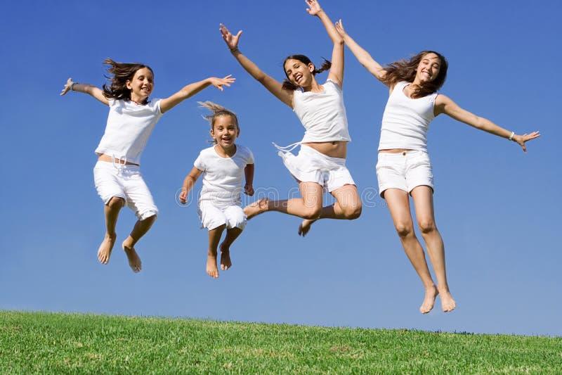 Happy group jumping at summer camp stock photos