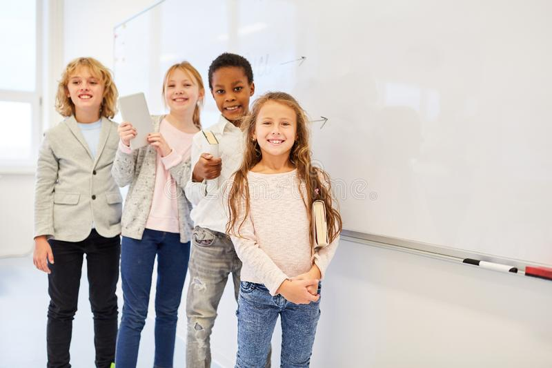Happy group of kids with tablet computer royalty free stock photography