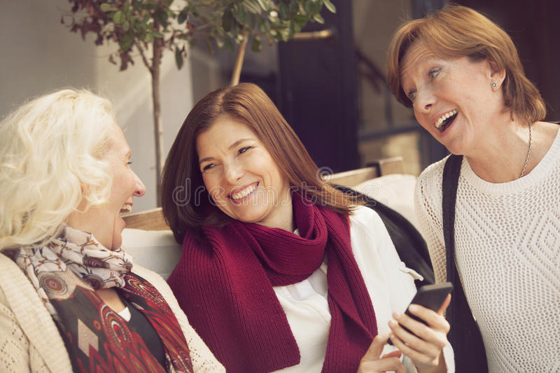 Happy group of mature women having fun. With mobile phone royalty free stock photo