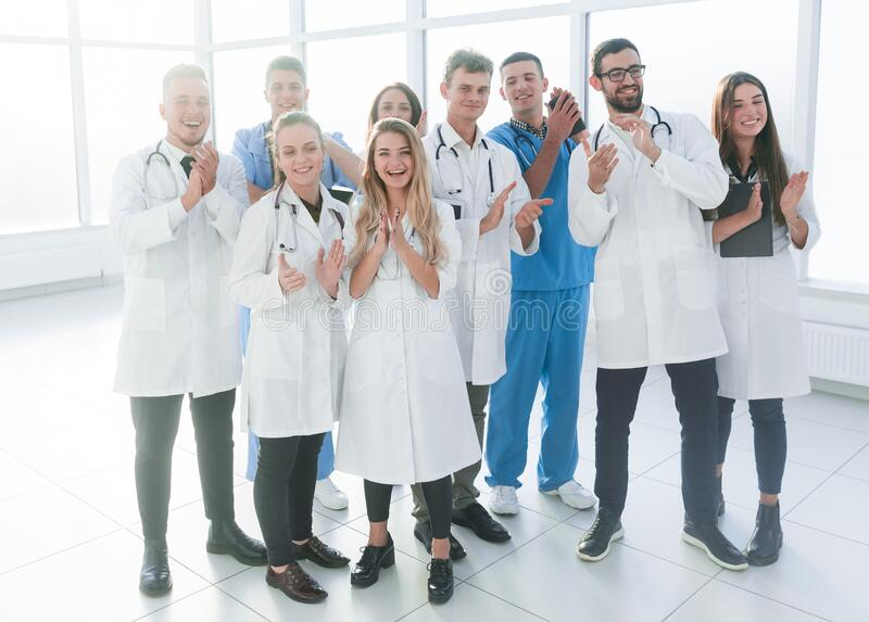 Happy group of medical professionals showing their success. royalty free stock photography
