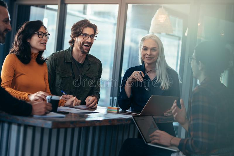 Happy group of people having meeting in office stock photos