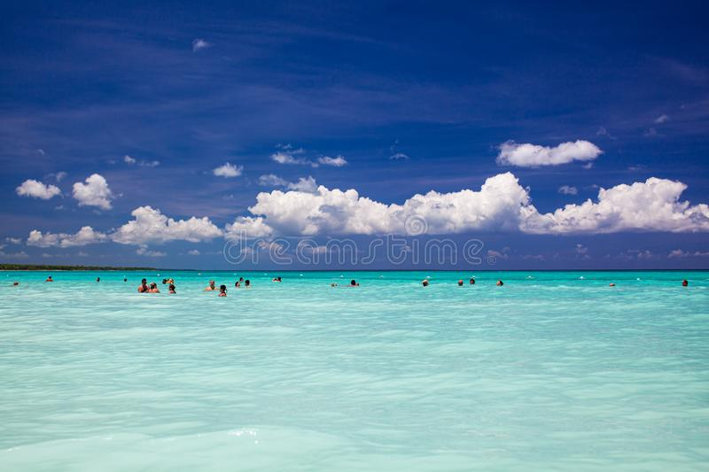 Happy group of people swimming in a carribean sea royalty free stock images
