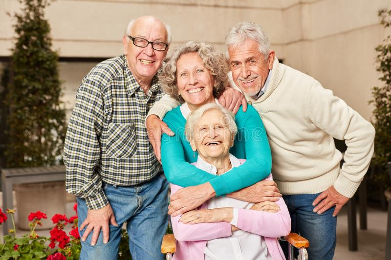 Happy group of seniors as friends royalty free stock images