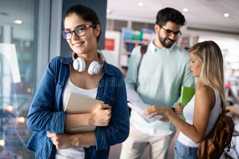 Happy group of students studying and learning together in college stock photos