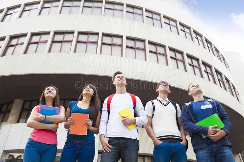 Happy group of students standing together stock images