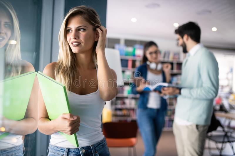 Happy group of students studying and learning together in college stock images