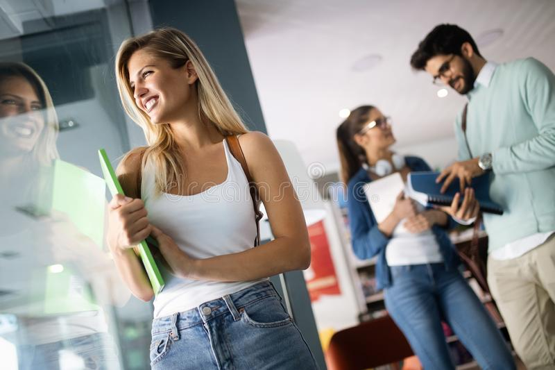 Happy group of students studying and learning together in college royalty free stock photography