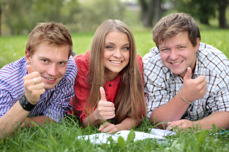 Happy group of students with thumbs up stock photography