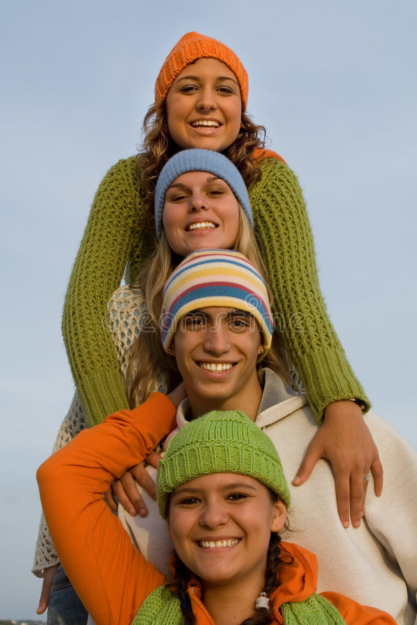 Happy group of teens or teenagers. Group of happy smiling teens, teenagers or youth royalty free stock photos
