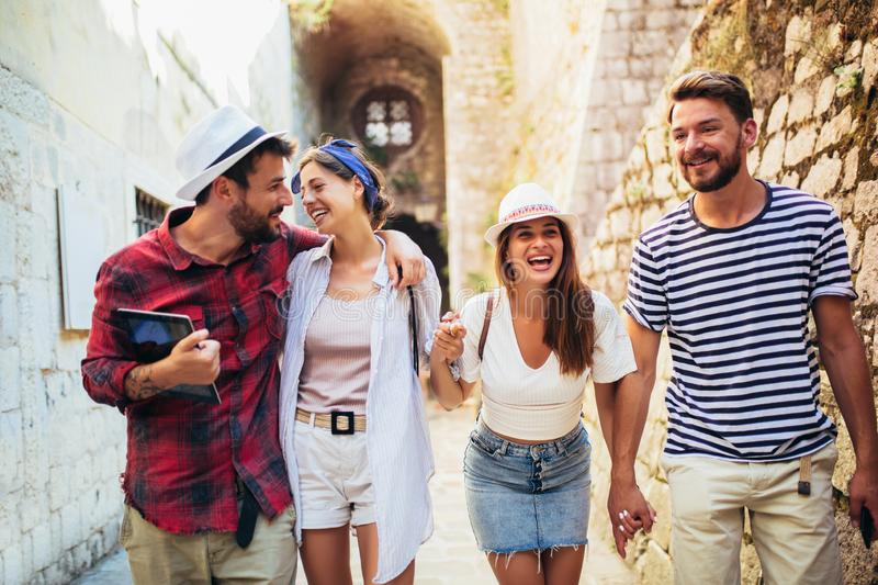 Group of tourists traveling and sightseeing together royalty free stock photo