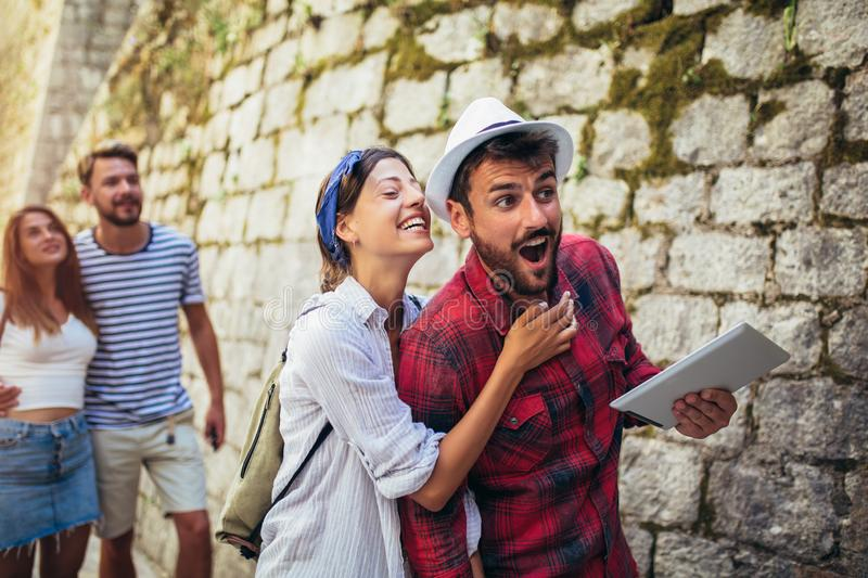 Group of tourists traveling and sightseeing together stock photo