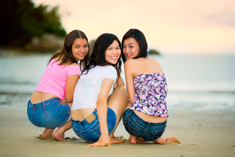 Happy Group Of Woman At The Sunset Beach Stock Photo