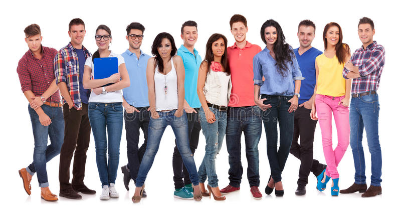 Happy group of young casual people standing together stock photo
