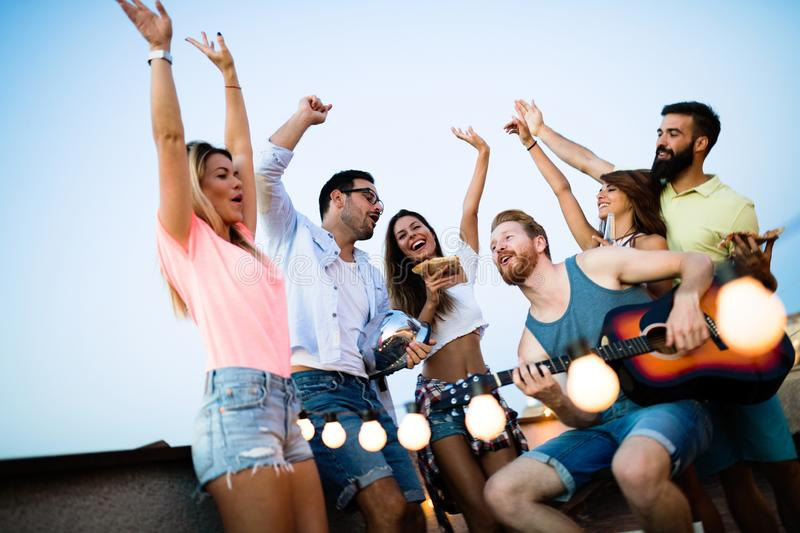 Happy group of young friends having fun in summer royalty free stock photo