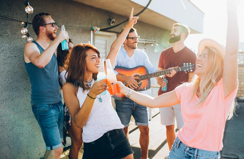 Happy group of young friends having fun in summer stock photography
