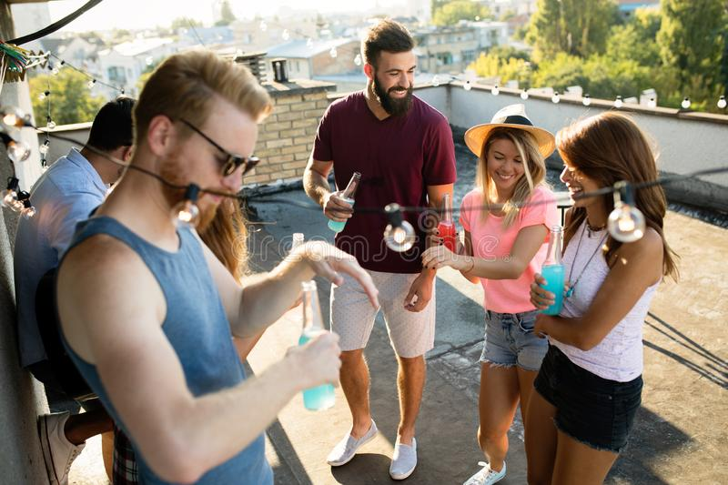 Happy group of young friends having fun in summer stock images