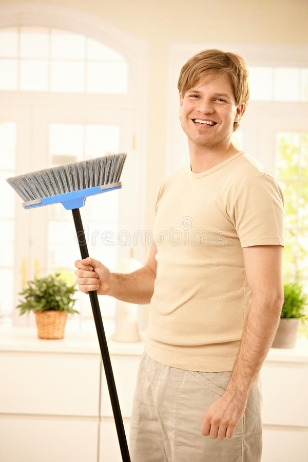 Download Happy guy with broomstick stock image. Image of broom - 19674249