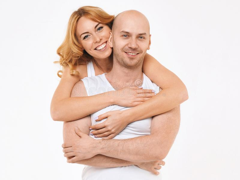 Happy guy and girl. Girl is hugging the boy. Love story. royalty free stock photos