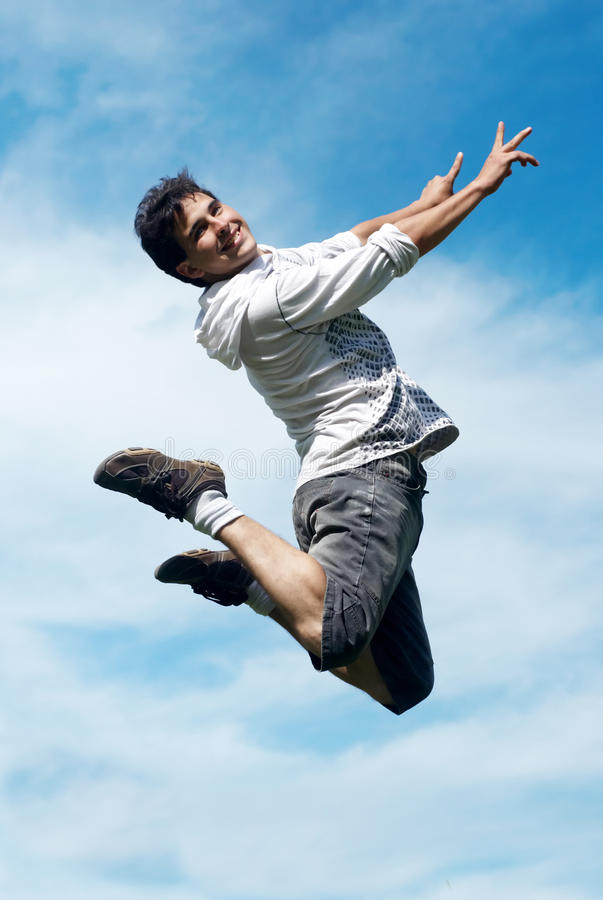 Happy guy jumping royalty free stock photo