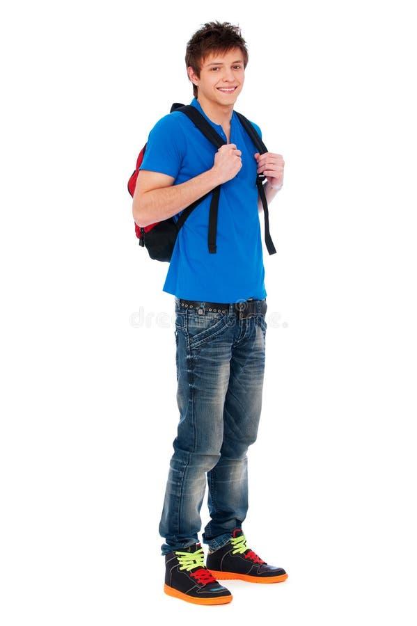 Happy guy with knapsack. Full-length portrait of happy guy with knapsack royalty free stock photography