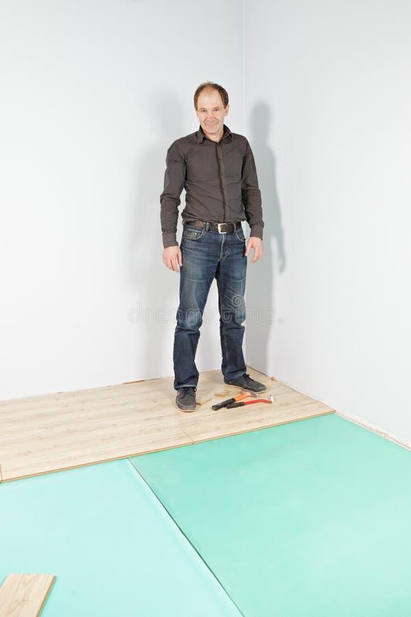 Download Happy guy in new flat stock image. Image of wooden, floor - 24708517