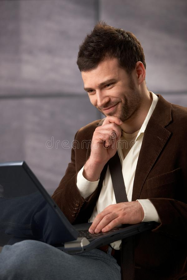 Download Happy Guy Smiling With Laptop Stock Image - Image of daylight, laptop: 16892179