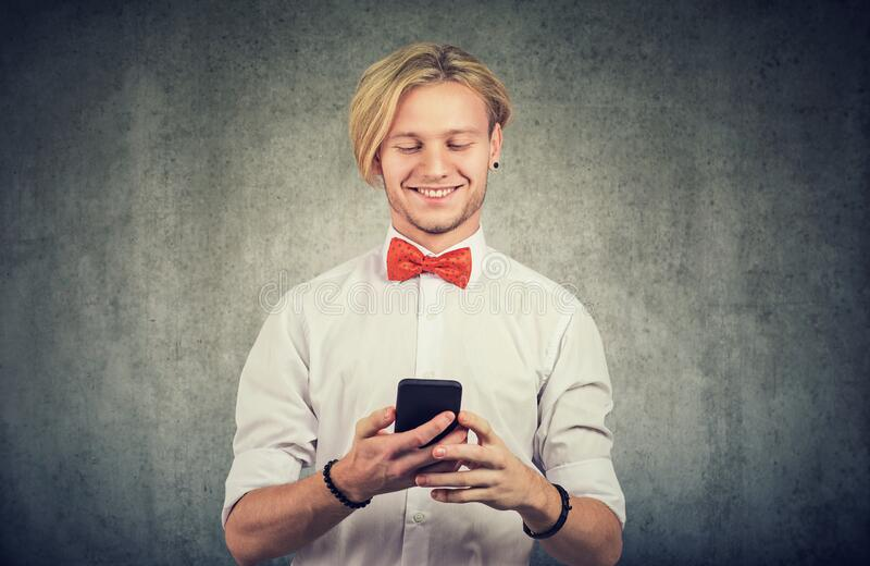 Happy guy using his smart phone royalty free stock photo