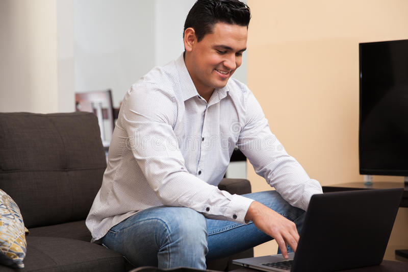 Happy Guy Working From Home Stock Photo
