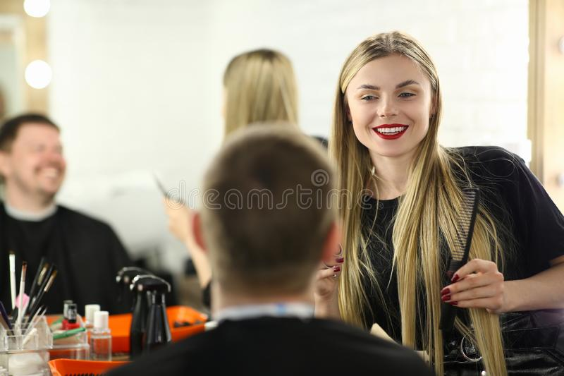 Happy Hairdresser Styling Male Hairdo for Client. Blonde Hairstylist Making Haircut for Man Customer. Woman Barber Working on Hairstyle in Barbershop. Stylist stock photography