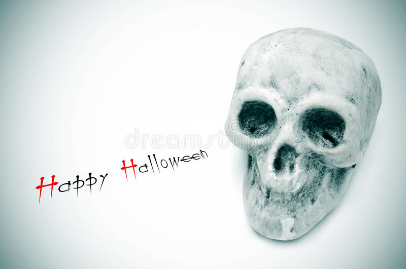 Happy halloween. Greeting card with the sentence happy halloween and a skull royalty free stock photos
