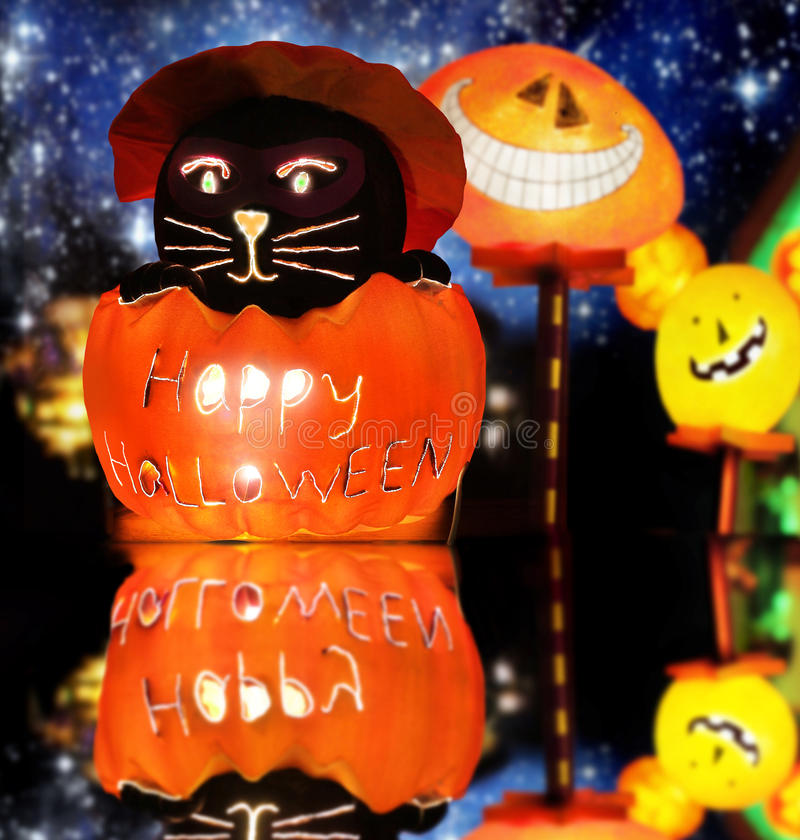 Happy Halloween. Lit up stylized Halloween composition of warm glowing spooky fun figures against fantastical night background royalty free stock images