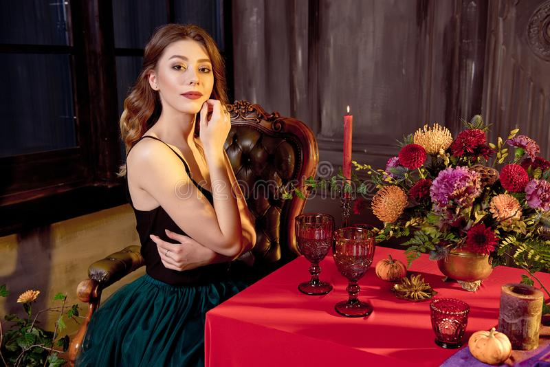 Happy Halloween.Attractive young woman getting ready for Halloween by setting the table for a festive dinner. Beautiful. Woman pumpkin stock photo