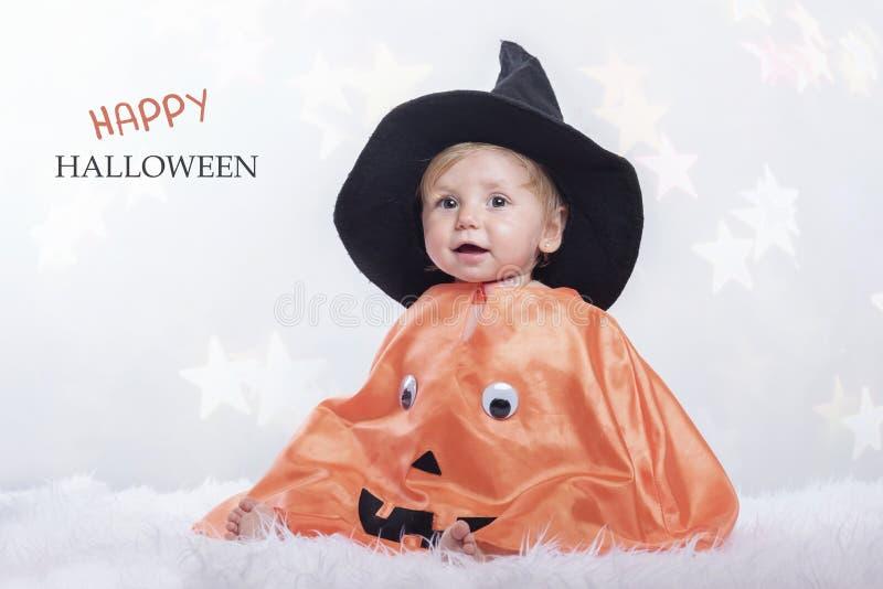 Happy halloween. Baby disguised in halloween stock image