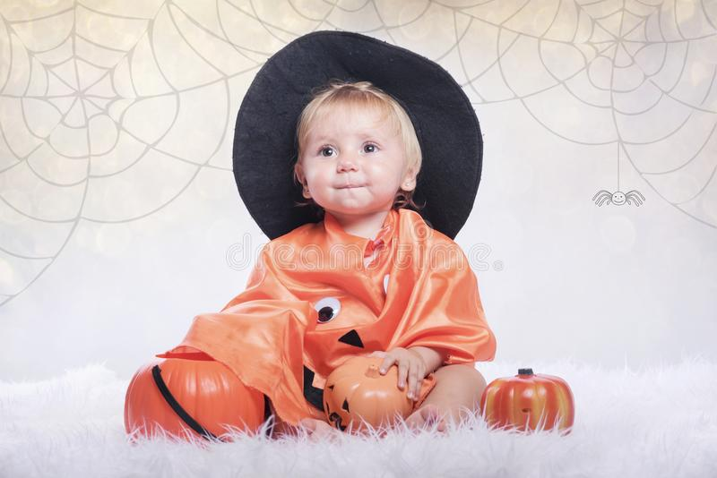 Happy halloween. Baby disguised in halloween stock photos