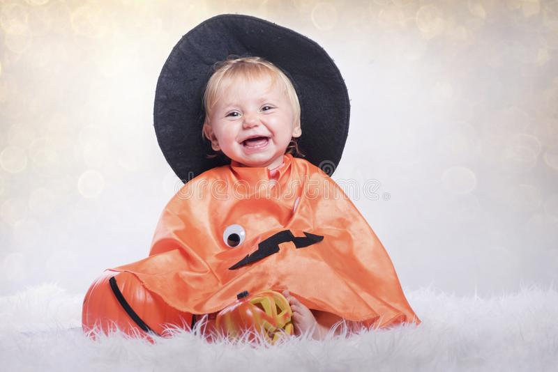 Happy halloween. Baby disguised in halloween stock photo