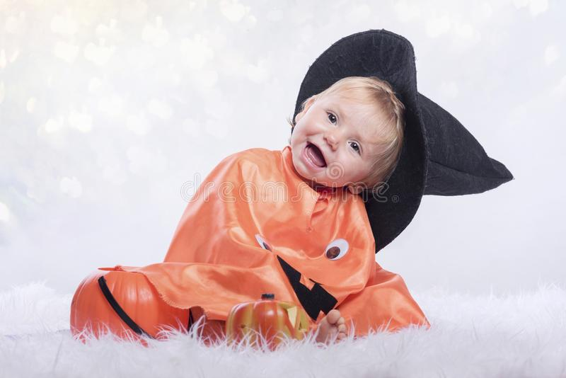 Happy halloween. Baby disguised in halloween royalty free stock images