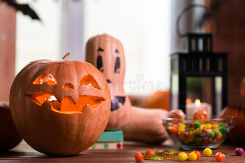 Happy Halloween. Background in front of a window with pumpkins,. Lantern, spiders and other symbols of a terrible holiday stock images
