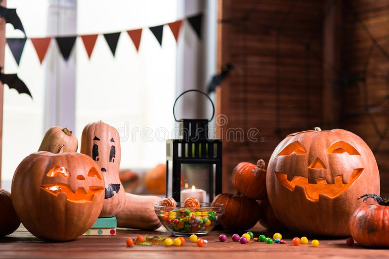 Happy Halloween. Background in front of a window with pumpkins,. Lantern, spiders and other symbols of a terrible holiday stock image