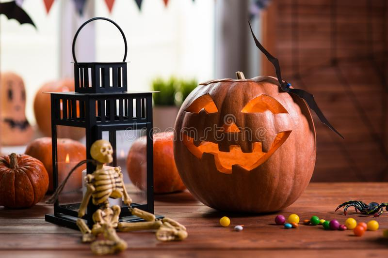 Happy Halloween. Background in front of a window with pumpkins,. Lantern, spiders and other symbols of a terrible holiday royalty free stock image