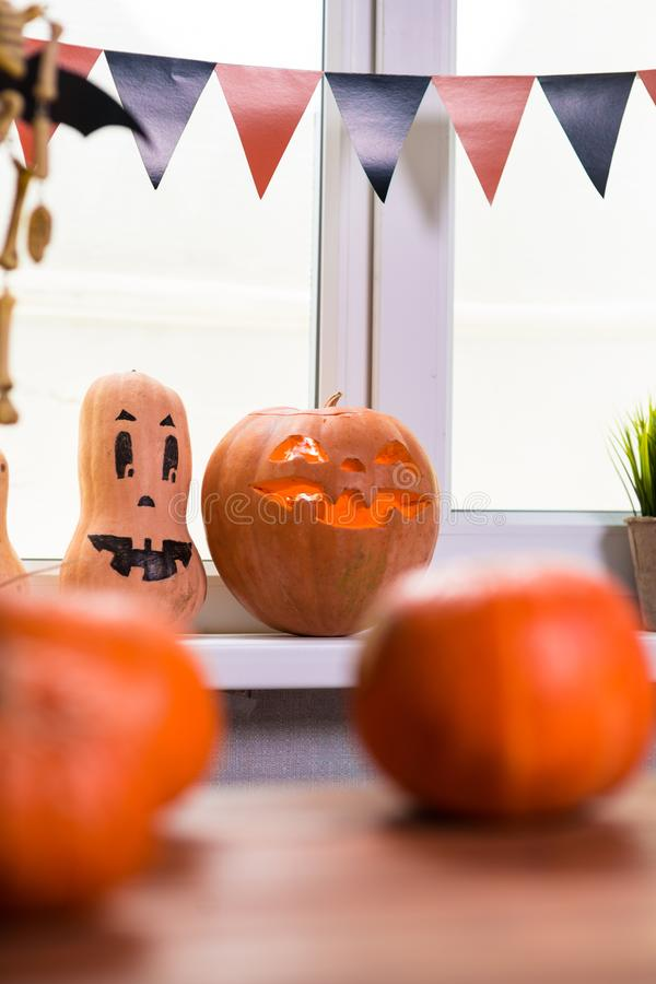 Happy Halloween. Background in front of a window with pumpkins,. Lantern, spiders and other symbols of a terrible holiday royalty free stock photo