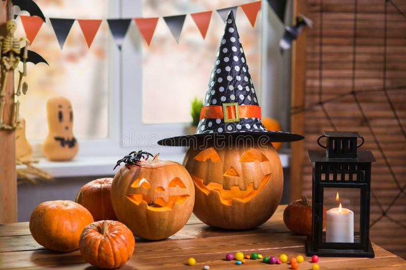 Happy Halloween. Background in front of a window with pumpkins,. Lantern, spiders and other symbols of a terrible holiday stock photography