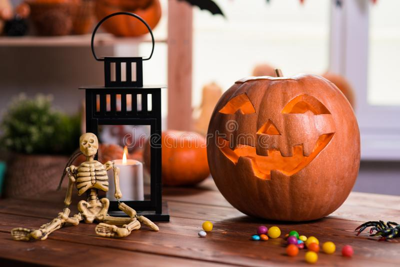Happy Halloween. Background in front of a window with pumpkins,. Lantern, spiders and other symbols of a terrible holiday stock photos
