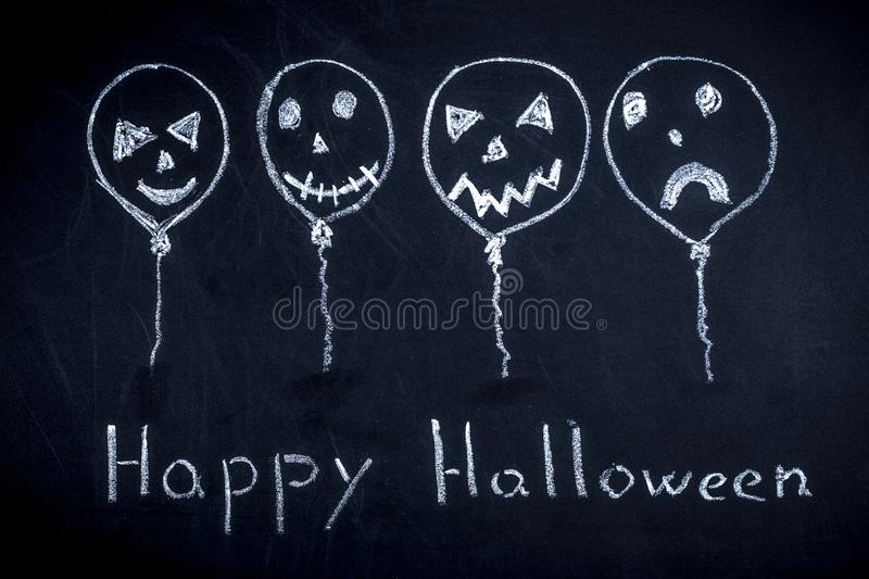 Happy halloween. Balls drawn with chalk with funny faces, concept happy halloween stock photo